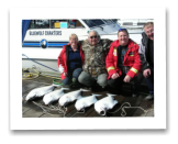 March 24, 2014: 23 to 29 lbs. Halibut - Constance Bank  - Bob, Terance, Audeen Jones from Grand Prairie with Darrel from Chemainus